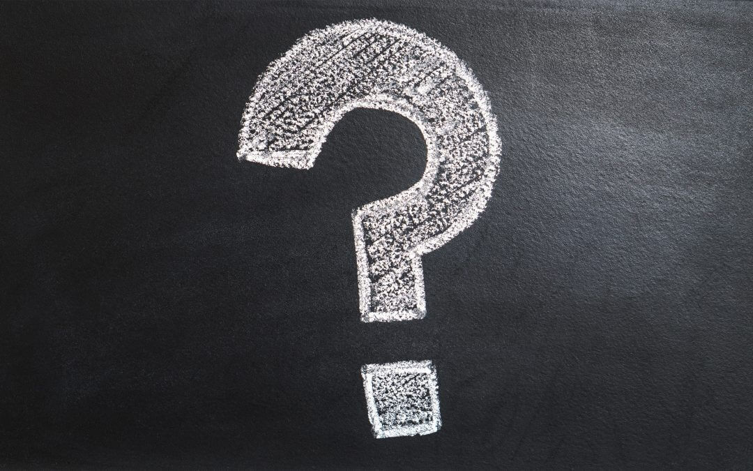 A big question mark is drawn on a chalkboard questioning the use of email marketing
